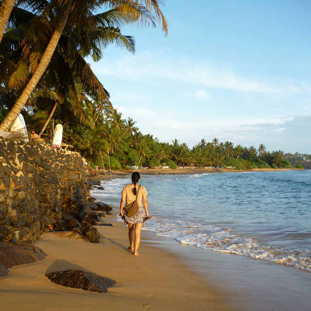 Image of a girl walking on Mirissa Beach in Sri Lanka